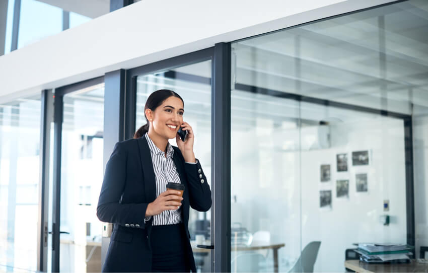 Confident woman on phone staffing solutions
