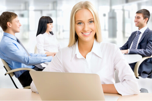 Confident smiling woman in office