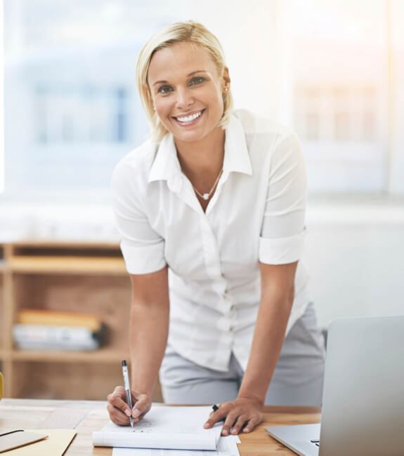 Blond lady working on invoices