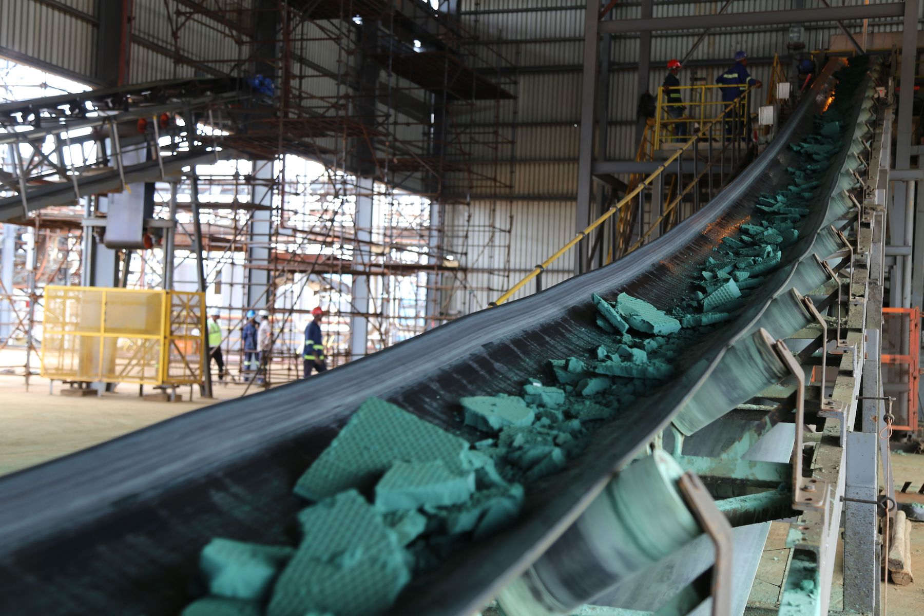 A conveyor belt carries chunks of Raw cobalt after a first transformation at a plant in Lubumbashi
