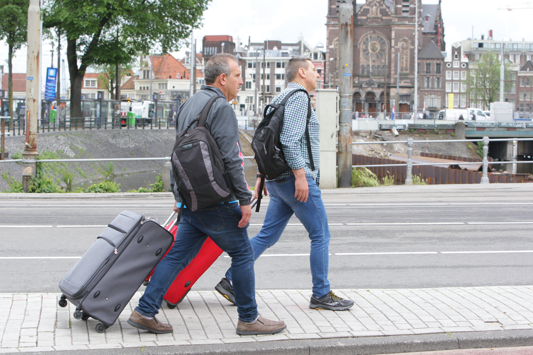 Tourists walking with suitcases in Amsterdam, Netherlands