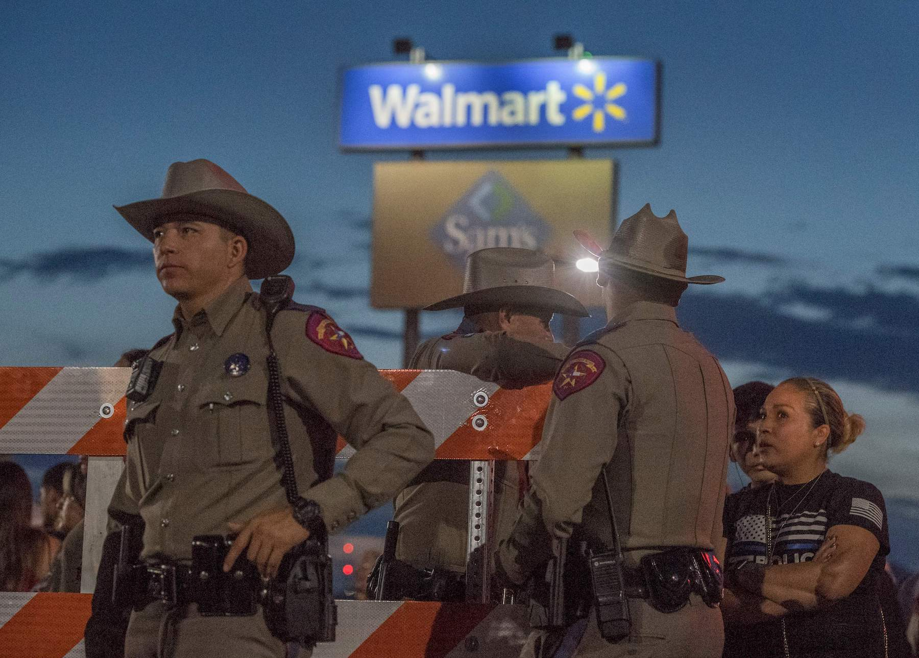 Texas State Troopers keep watch at the makeshift memorial at the Cielo Vista Mall WalMart in El Paso, Texas, on August 6, 2019