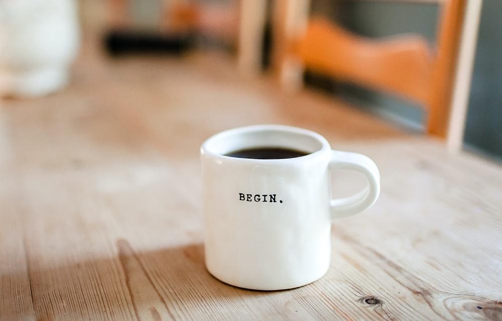 Coffee mug with Begin written on it