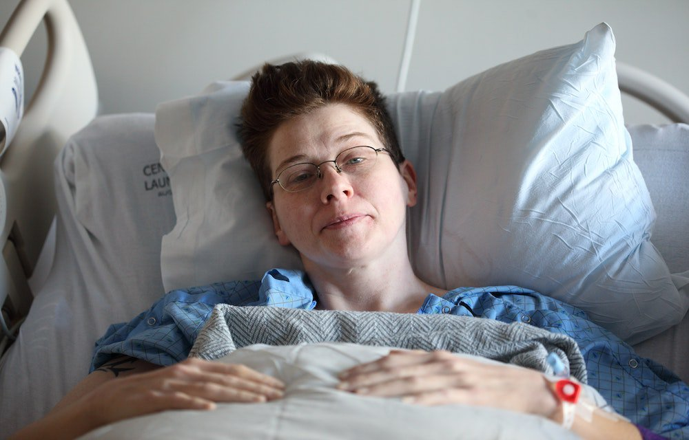 Sick lady in hospital bed