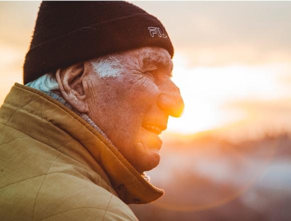 Elderly man looking at sunset