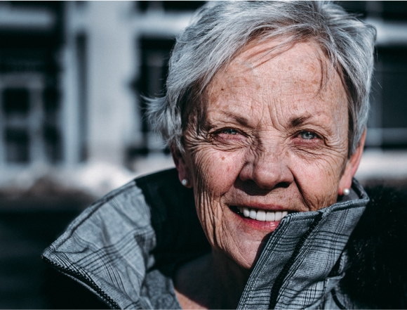 Portrait of white haired elderly woman with winter jacket