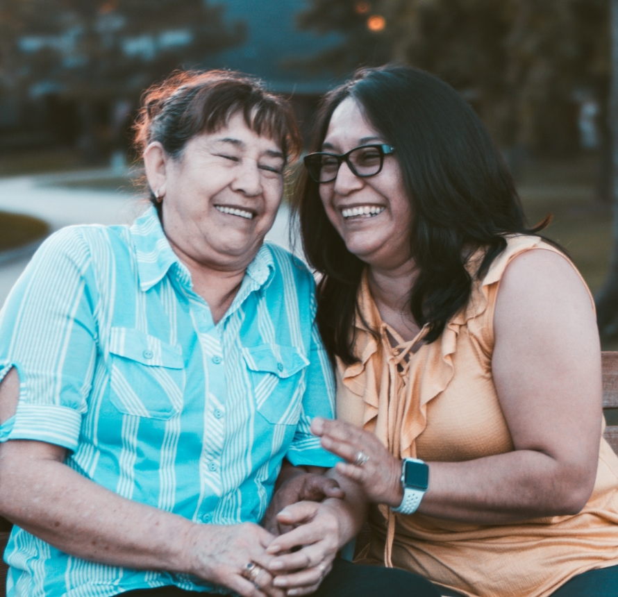 Two women laughing.