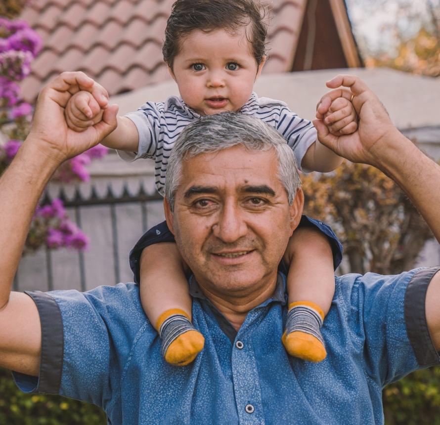 Granddad giving shoulder ride.