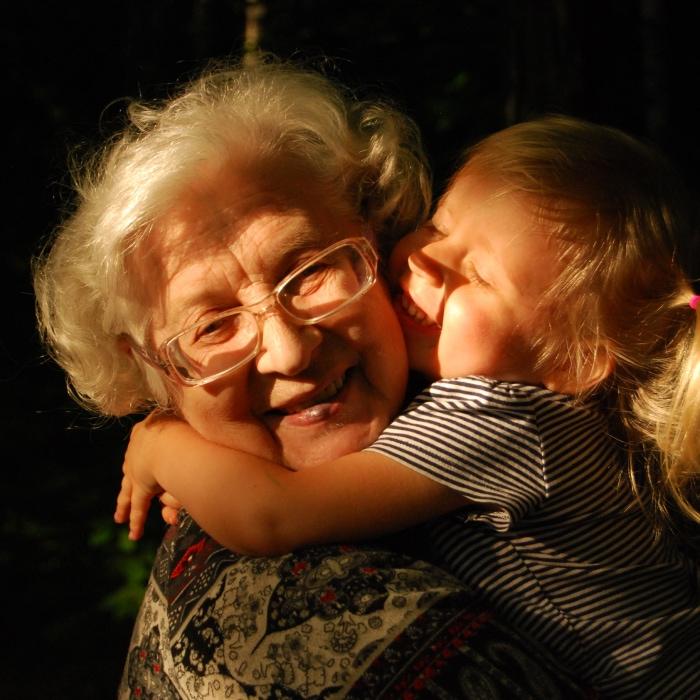 Grandma and grandchild hugging.