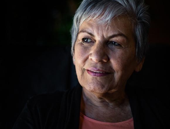 Elderly woman looking on