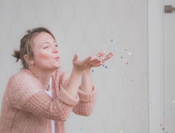 Mum blowing confetti