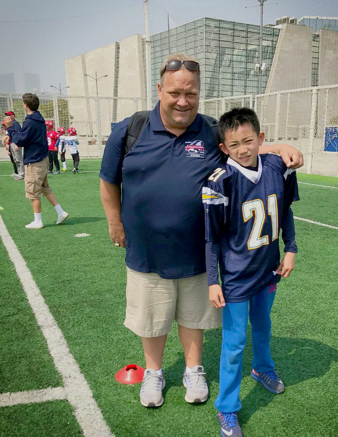 Coach and a student at one of his camps
