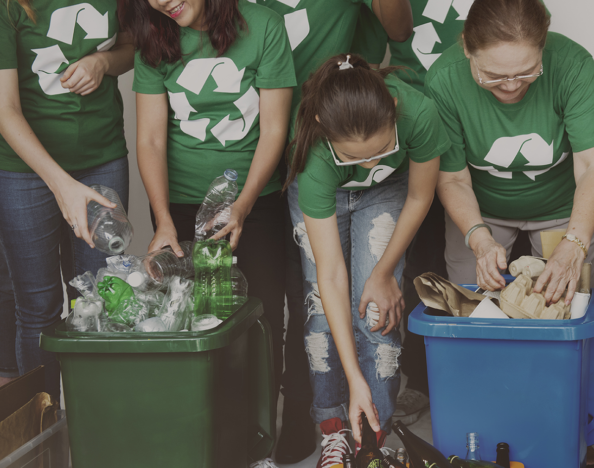 People sorting recycling