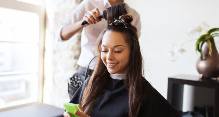 customer in salon on phone pre-booking