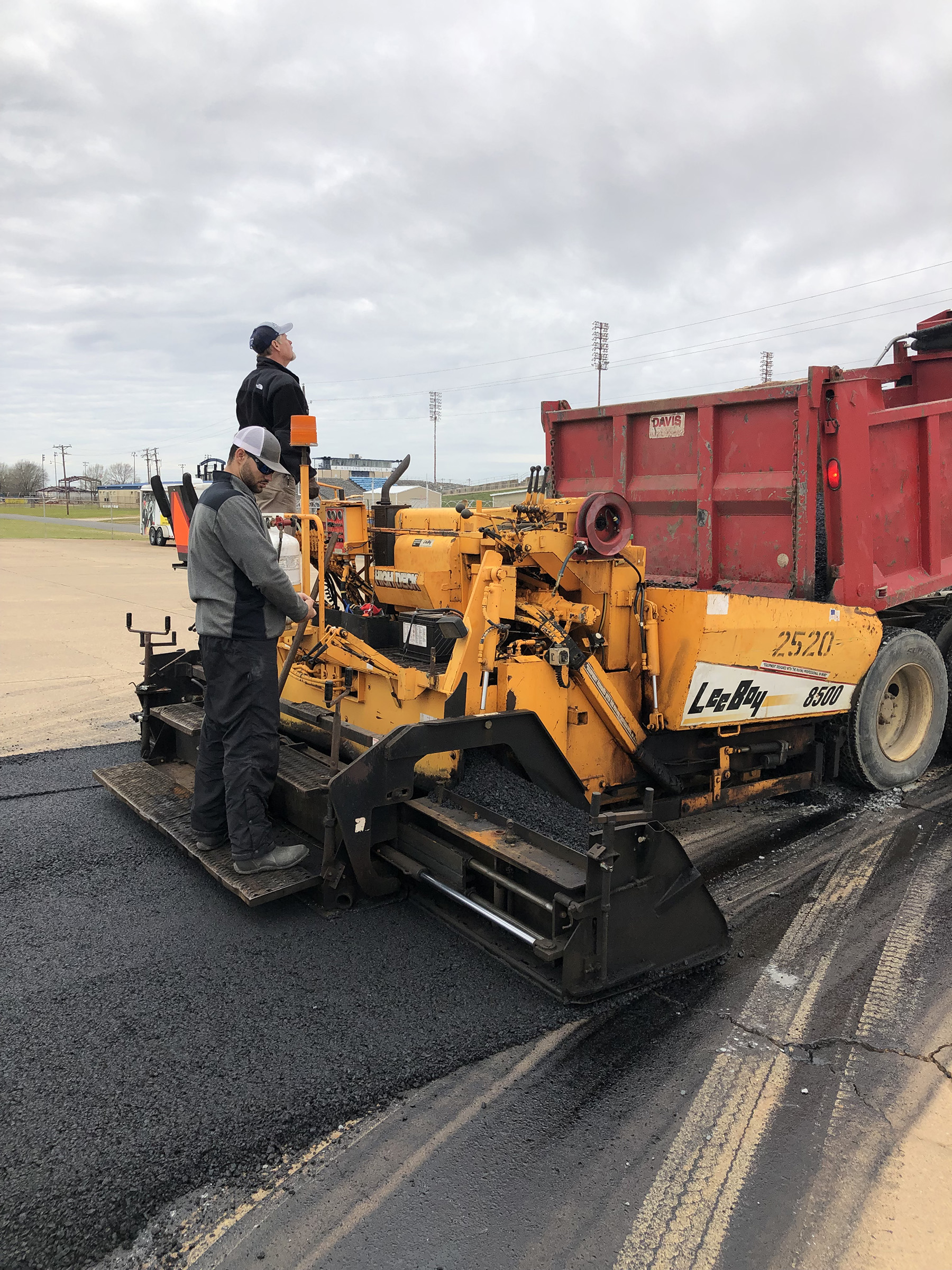 Man using an asphalt paver