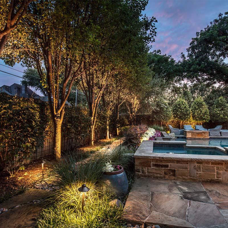 Backyard landscape lighting installation