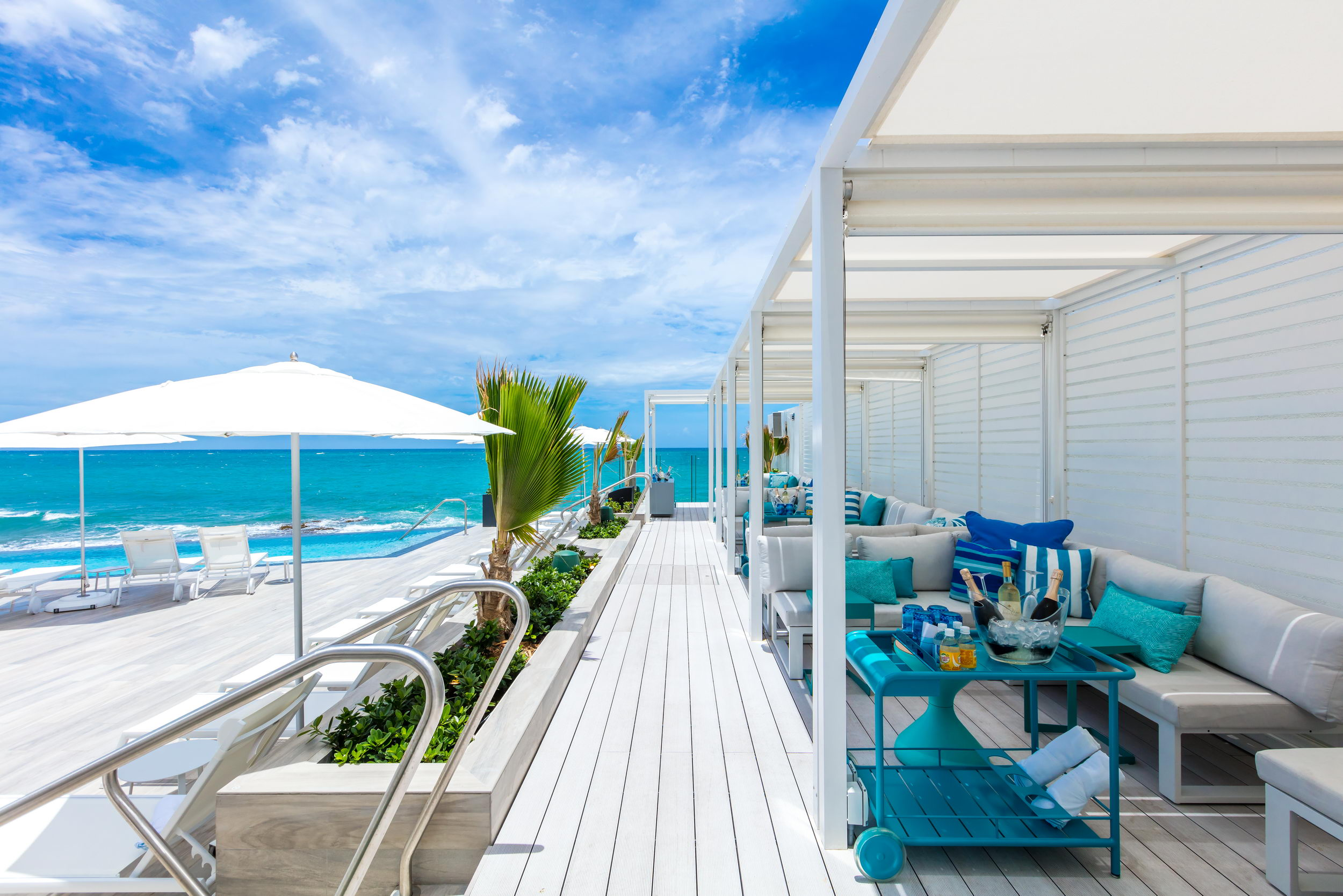 Poolside cabanas and ocean view