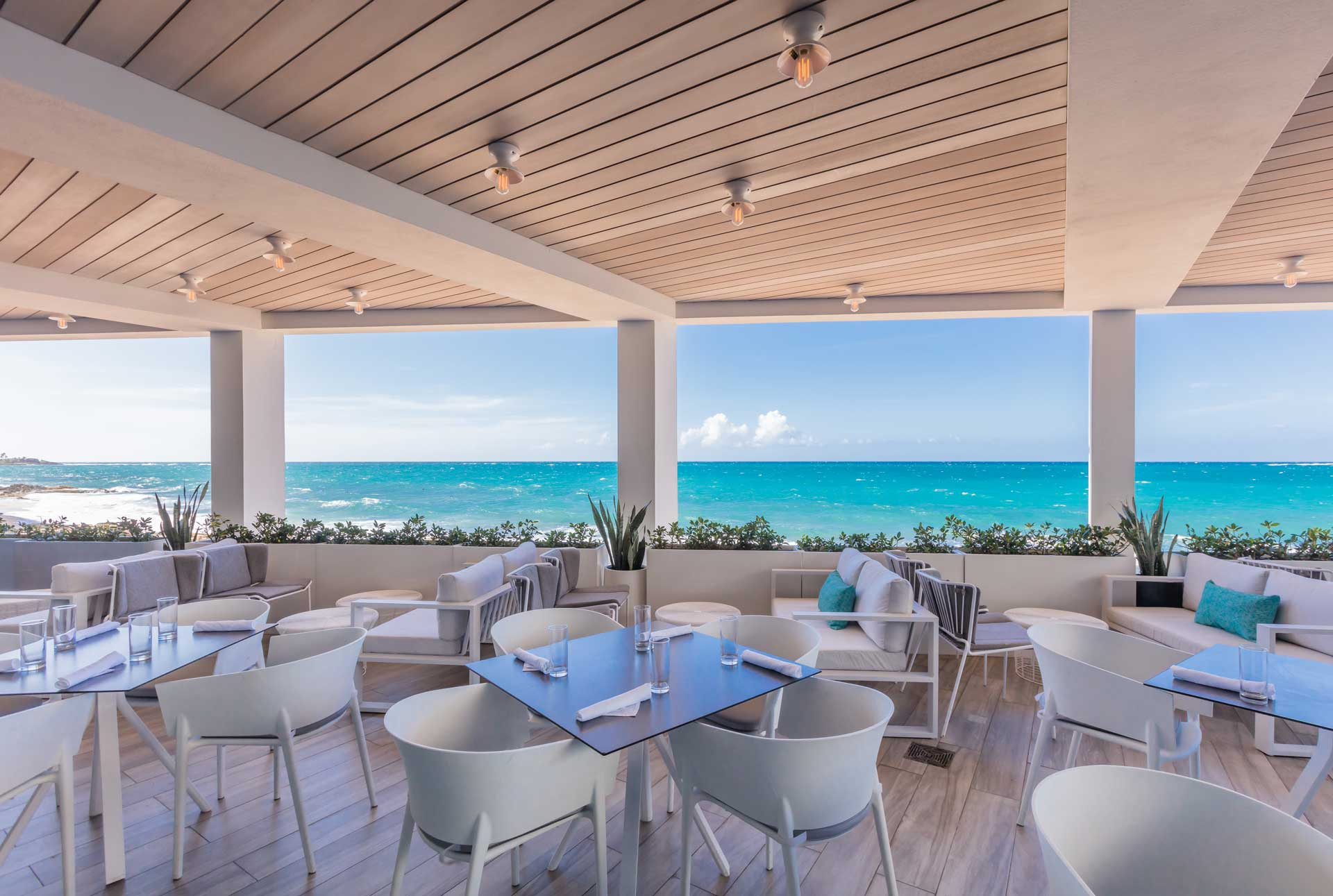 An outdoor covered dining area with ocean views