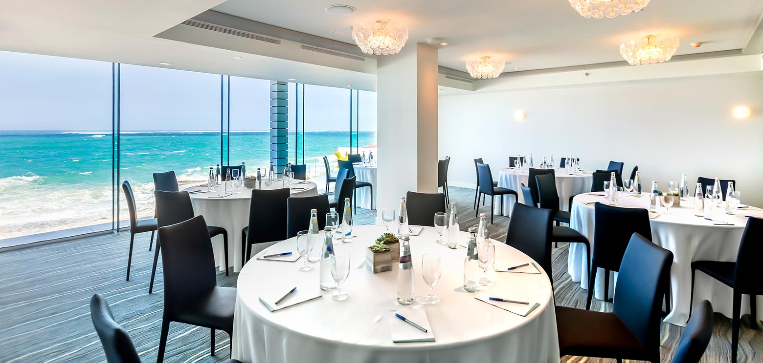 Circle tables and ocean views in one of meeting rooms