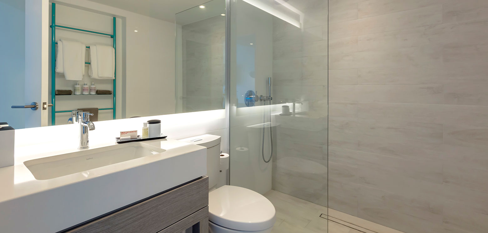 Room bathroom with glass paneled shower at Condado Ocean Club