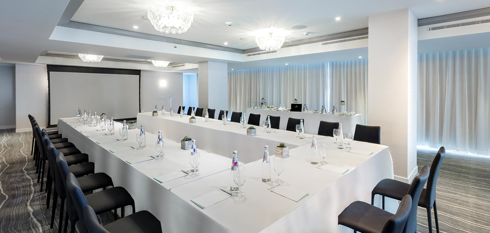 Large U shaped table in one of meeting rooms