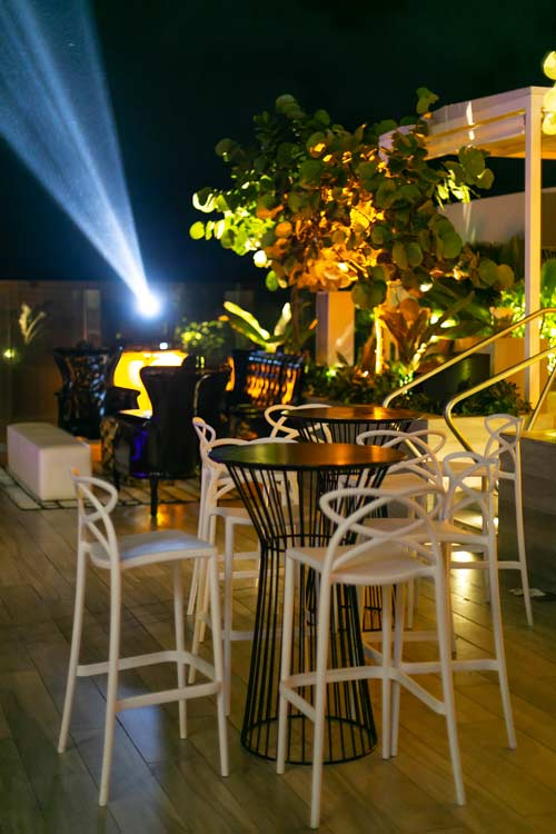 Outdoor dining area at night at the Condado Ocean Club