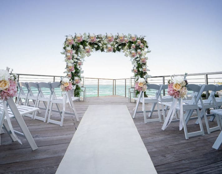Outdoor wedding venue in front of ocean