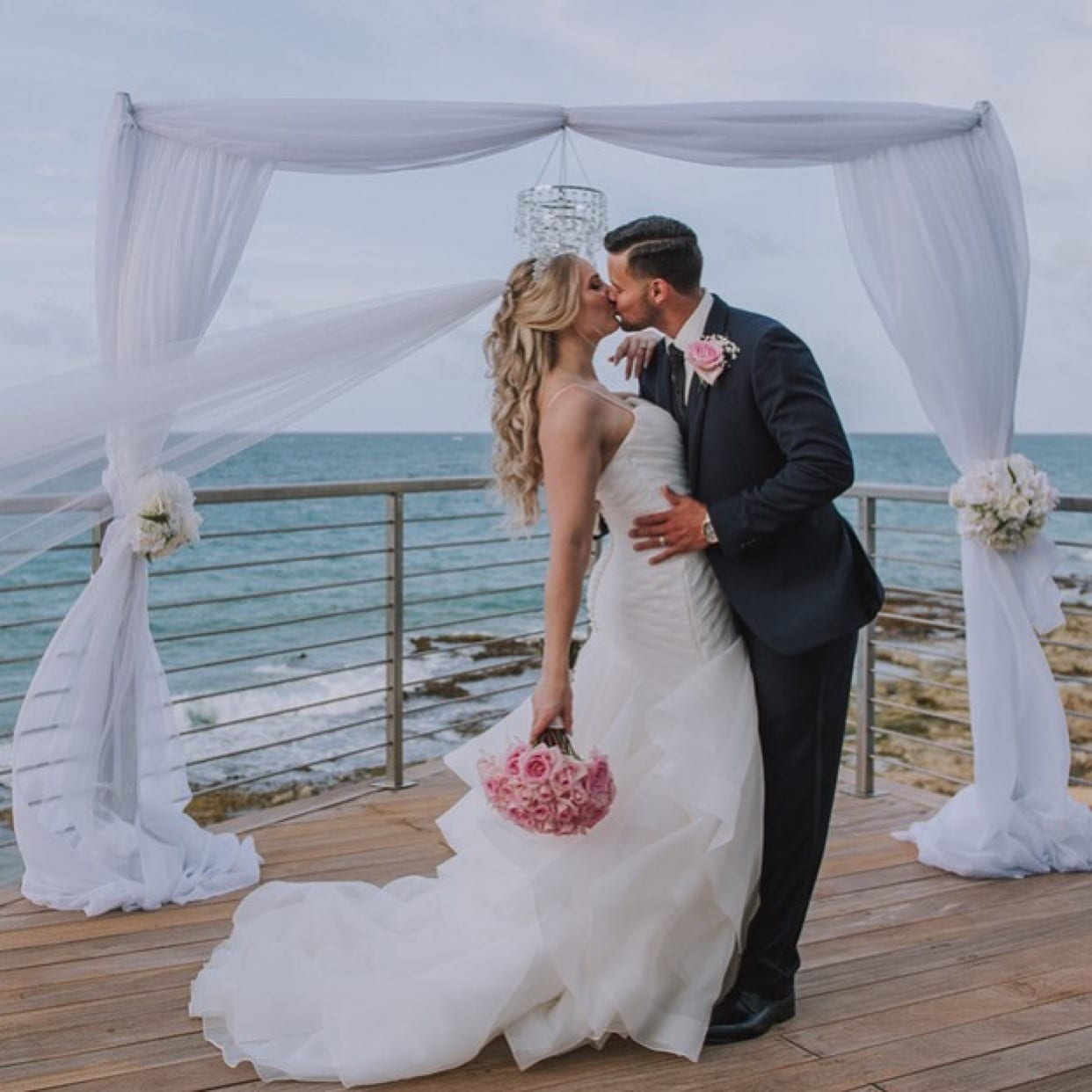 A just married couple at an outdoor wedding venue at Condado Ocean Club
