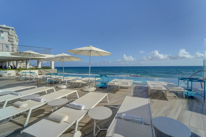 The outdoor pool and chaise chairs at Condado Ocean Club