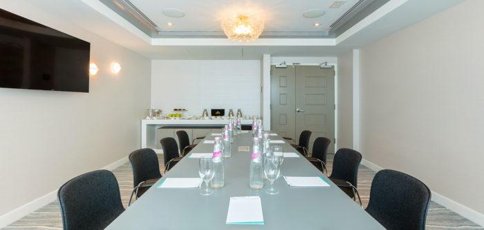 Long table and TV in meeting room at Condado Ocean Club