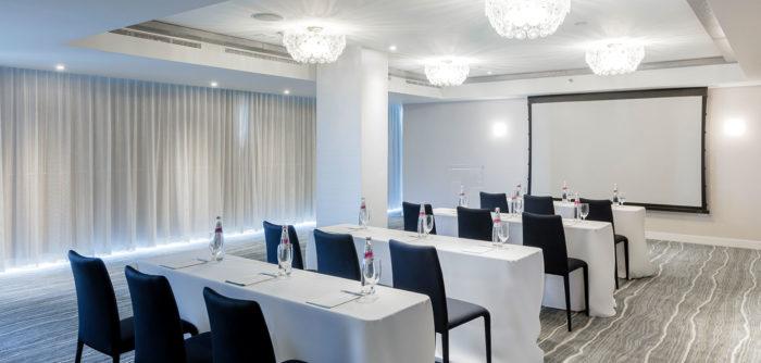 Multiple tables in one of meeting rooms at Condado Ocean Club