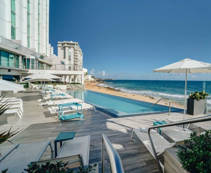 The outdoor pool and surrounding seating at the Condado Ocean Club