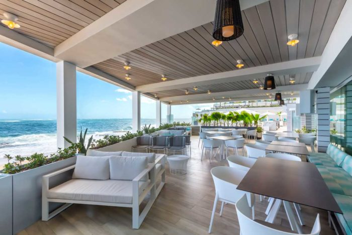Outdoor covered seating area on the ocean at Condado Ocean Club
