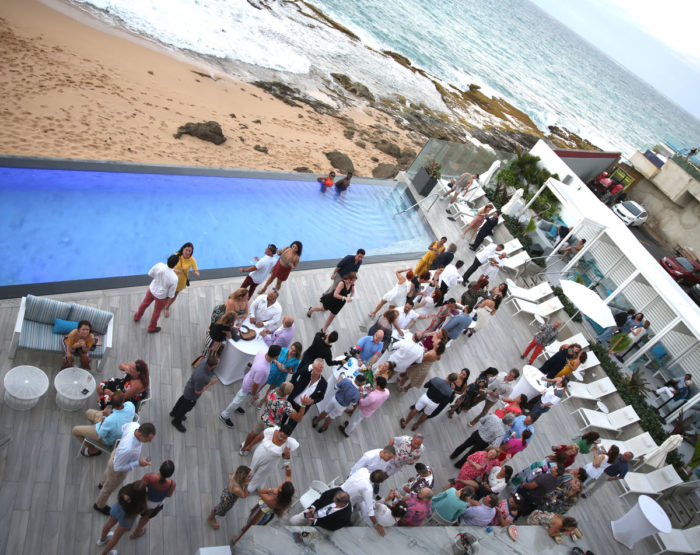 A gathering of people on the patio of Condado Ocean Club