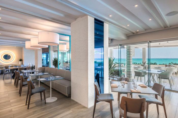 Indoor dining area with ocean views at the Condado Ocean Club