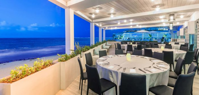 Dining tables with view of ocean at Condado Ocean Club