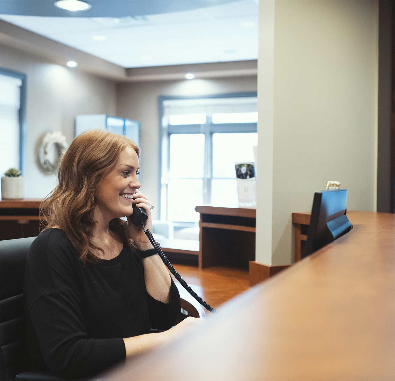 Photo of a team member talking on the phone