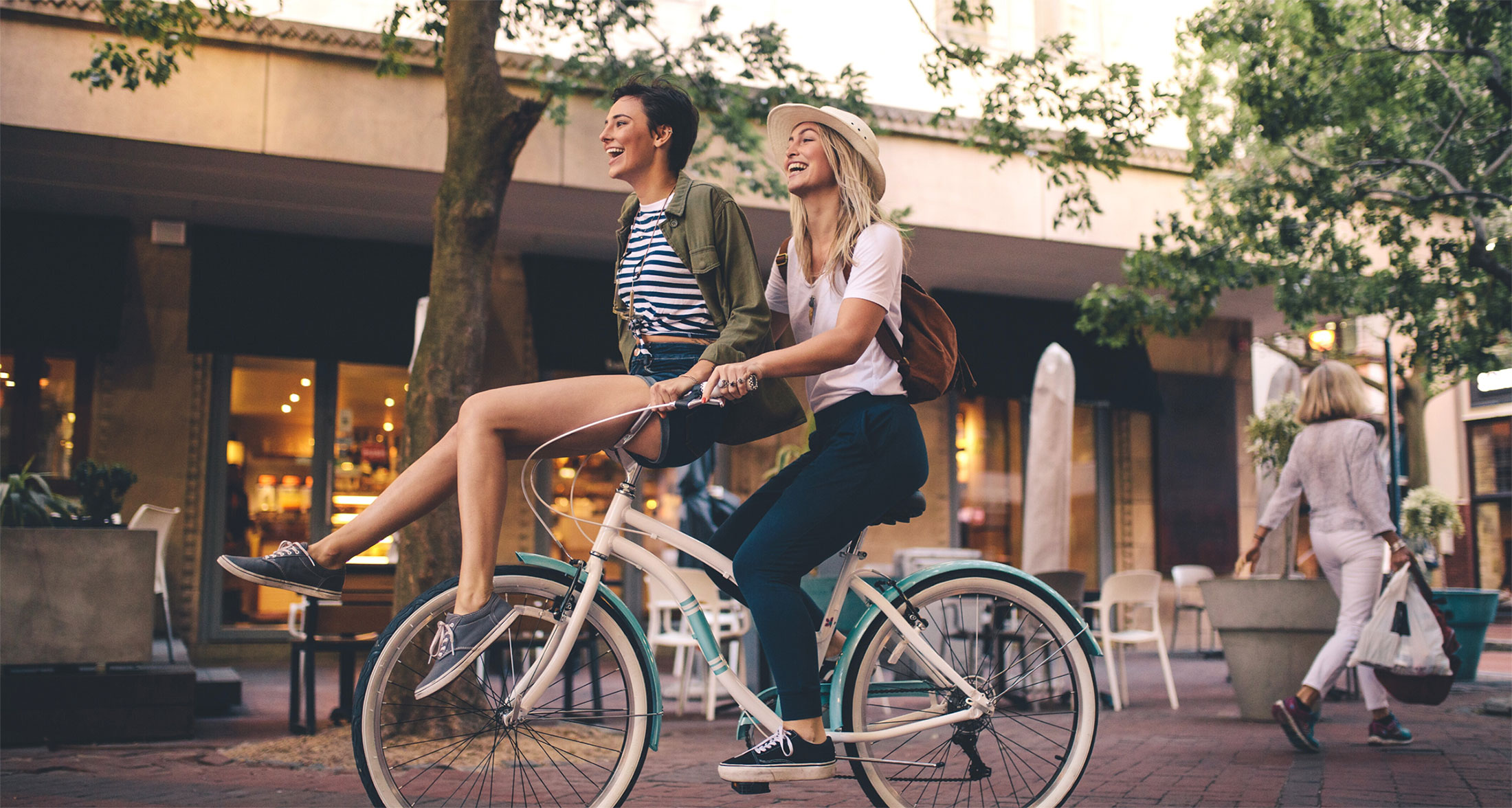 Two girlfriends on a bike.