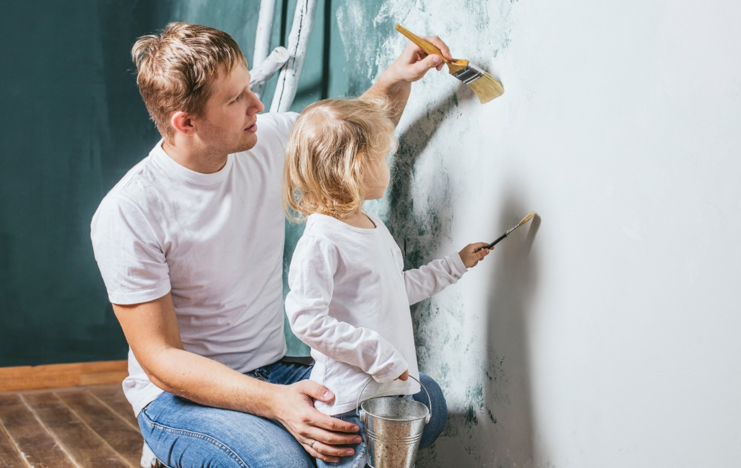 Dad and child painting.