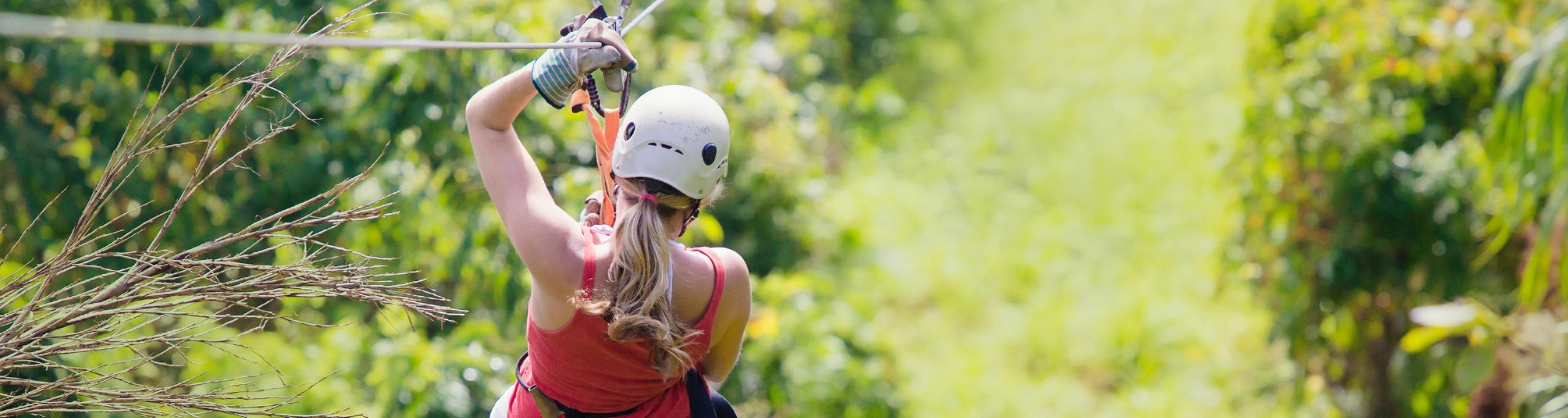 Woman ziplining.