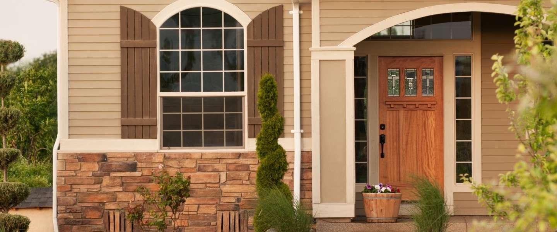 Front of brown doorway.
