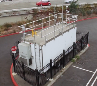 A Clarity Node colocated with a reference station in Oakland for wildfire smoke calibrations.