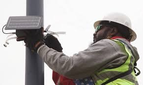 One of Clarity's real-time air quality monitoring devices being installed in Richmond.