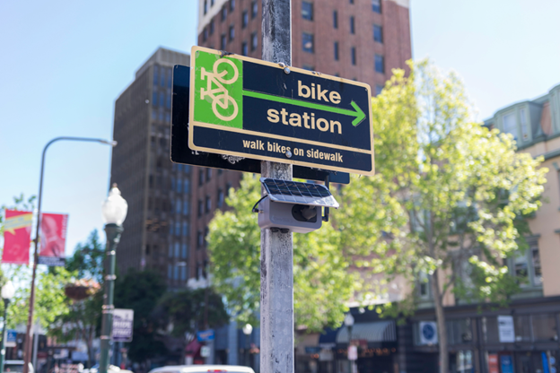 A Clarity Node-S low-cost air sensor installed on a streetlight in Berkeley, CA, to monitor air quality and assess the impact of green policies such as bike lanes.