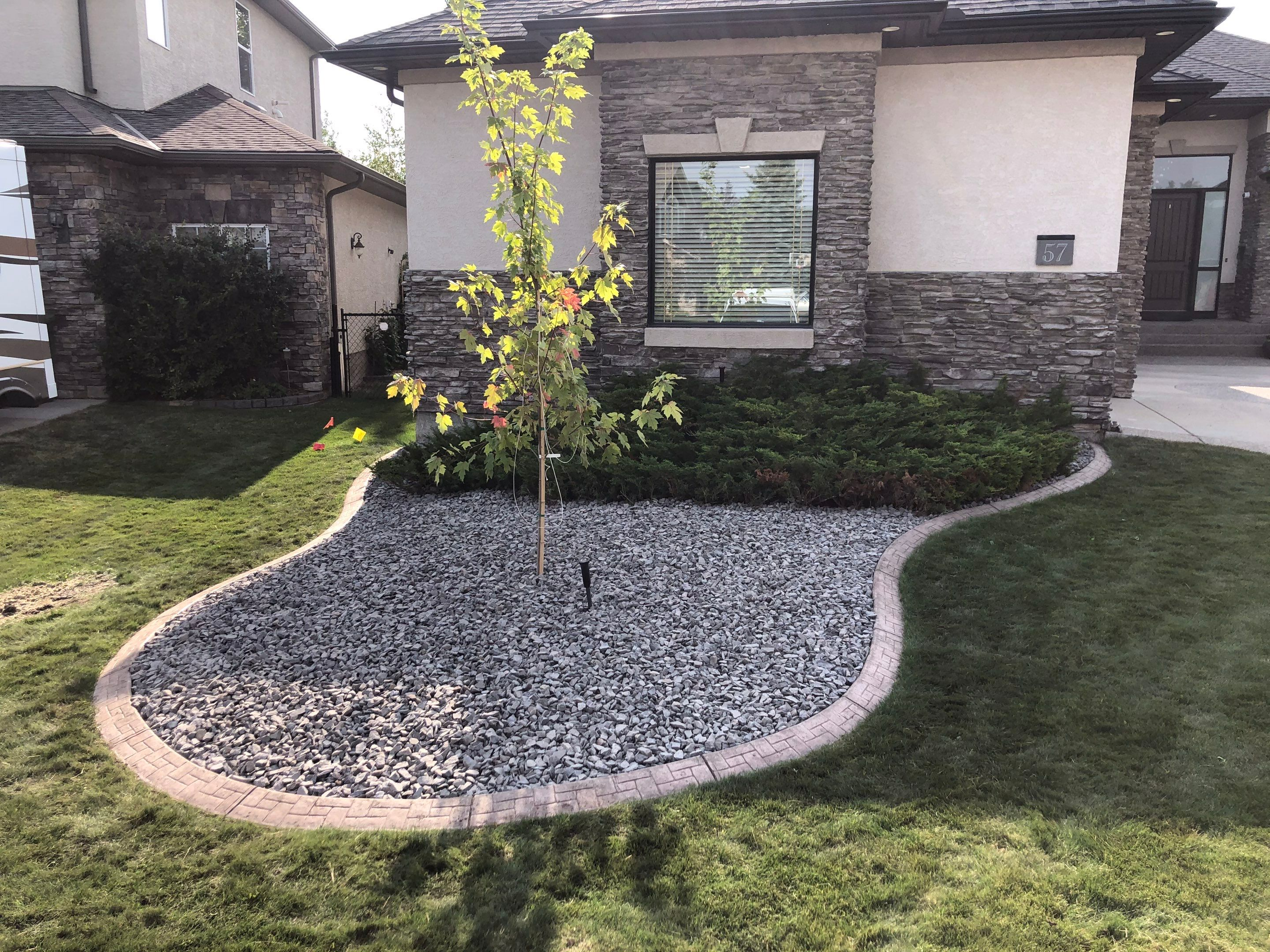 Transform the look of your yard at a lower price point. Our Softscape design team will bring your vision to life by installing flower beds, plant trees, shrubs, perennials, and annuals with mulching and xeriscaping installations. We can give your lawn an overhaul with sod installations and removal of trees and plants in Alberta.