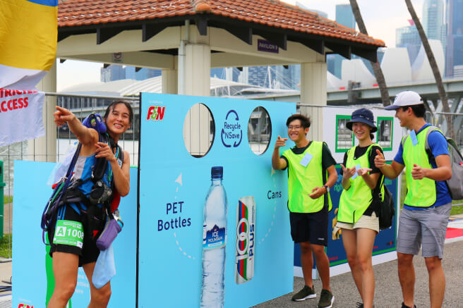 Three volunteers and Rima posing to the camera