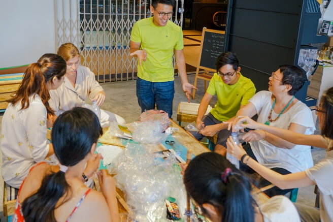 A group of participants interacting to each other in a workshop.