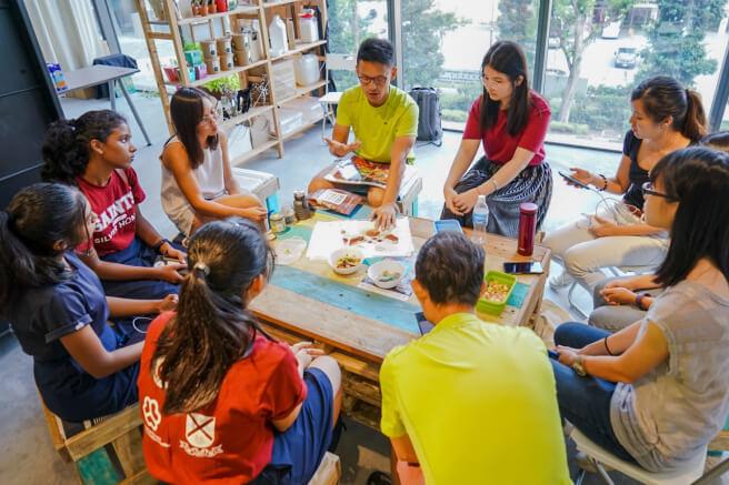 Participants listen to Li Seng in a workshop.
