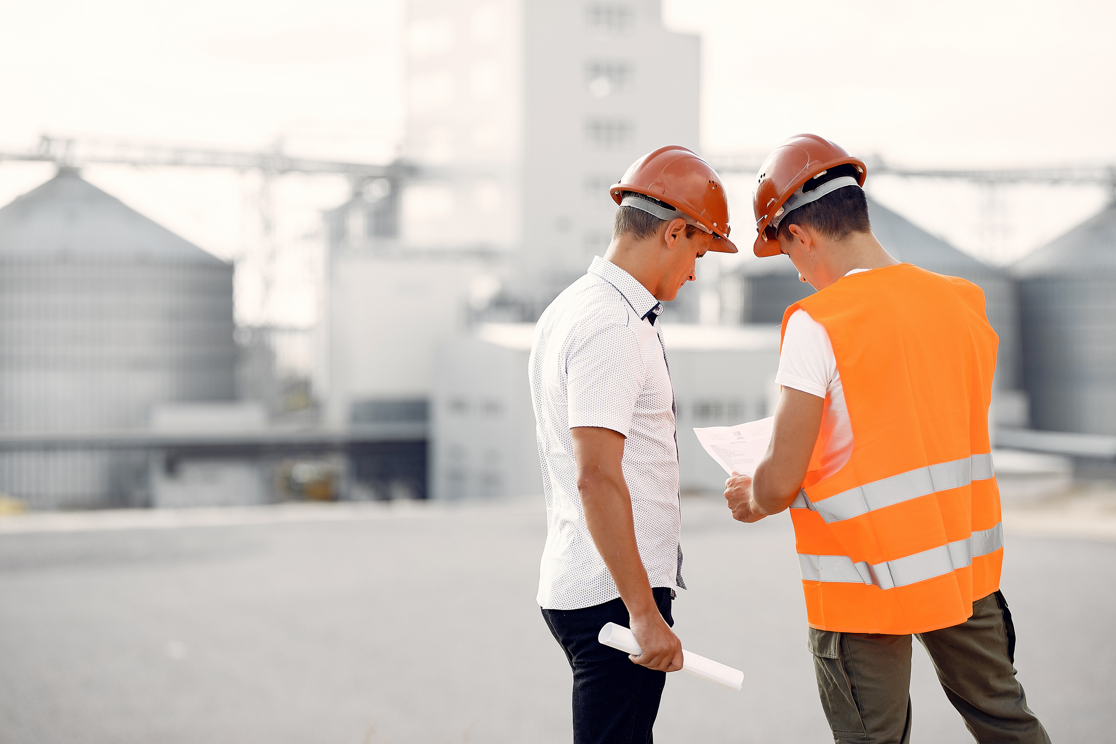 Workers looking at plans