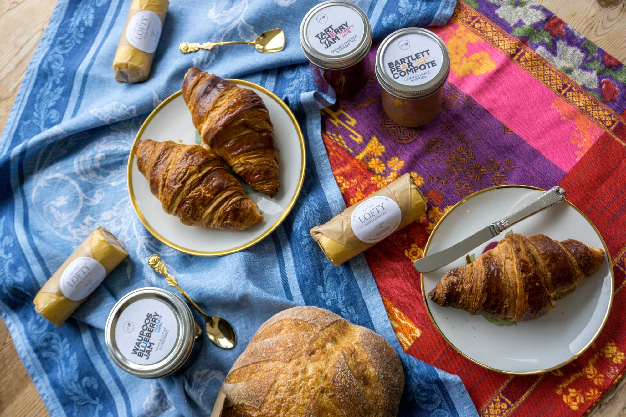 Croissants and preserves on a colourful blanket; part of a typical breakfast at The Empty Nest in Prince Edward County